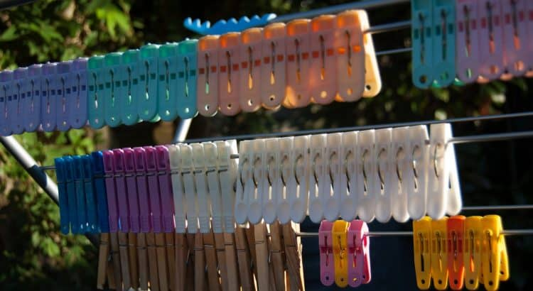 Artistic photo: variety of pegs hanging from a washing line