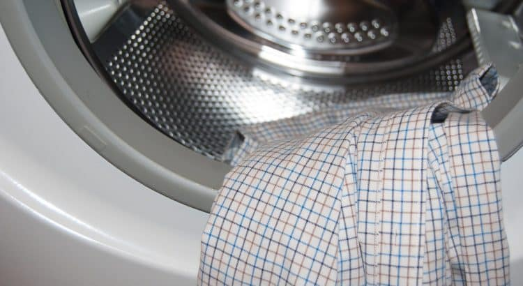 Artistic photo: Shirt lying on a door of a washing machine